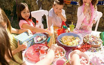 Children eating food at party
