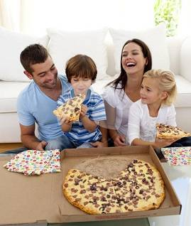 Parents and Kids Eating Pizza